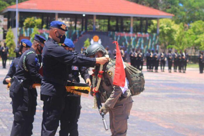 Satuan Brimob Polda Maluku menggelar upacara penyambutan 1 SSK personel Satbrimobda Maluku yang telah selesai melaksanakan tugas Bawah Kendali Operasi (BKO) Polda Papua, Senin (15/3/2021). Foto: Chintia Samangun